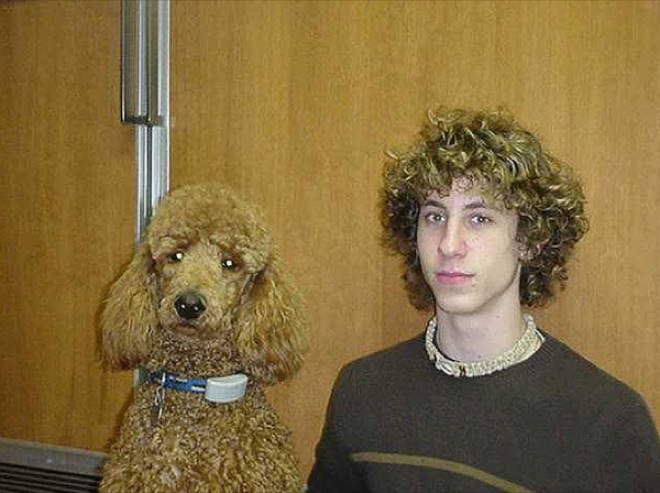 curly hair boy and brown dog
